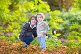 Baby girl and her teen age brother playing together — Stock Photo