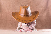 Baby wearing a cow girl outfit — Stock Photo