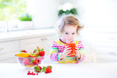 Beautiful toddler girl having breakfast — Stock Photo