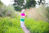 Baby girl walking in a park — Stock Photo