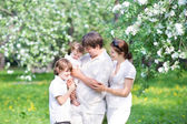 Family in a apple tree garden — Photo