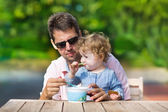 Father and his little baby daughter enjoying ice cream — Stock Photo