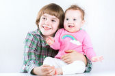 Brother hugging his baby sister — Stock Photo