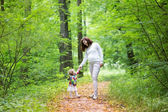 Pregnant woman and her baby daughter walking in forest — Stock Photo