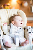 Baby in a high chair — Stock Photo