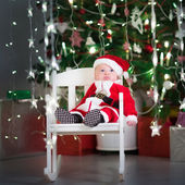 Baby boy in Santa costume — ストック写真