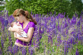 Young mother with her newborn baby — Stock Photo