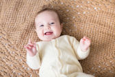 Baby girl laughing and playing — Stock Photo