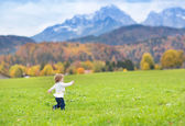 Little toddler girl running in a beautiful field — Photo