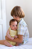 Brother with baby sister — Stock Photo