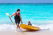 Father and son on a kayak — Stock Photo