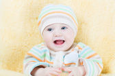 Sweet baby in a warm sheep skin foot muff — Stock Photo