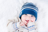 Baby in a blue knitted hat and a warm sweater — Stock Photo