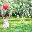 Baby girl playing with a red balloon — Stock Photo #43252095