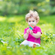Baby girl eating candy — Stock Photo #43250287