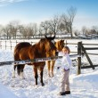 Boy playing with horses — Stock Photo #43250583