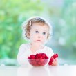 Girl eating raspberry — Stock Photo #43251117