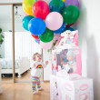 Little girl in a room decorated with birthday air balloons — Stock Photo
