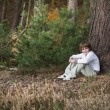 Little boy in a pinewood forest — Stock Photo #43251725