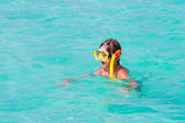 Boy snorkeling on a beach — Foto de Stock