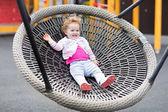 Baby girl relaxing on a swing — Stock fotografie
