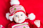Baby girl in a Christmas knitted dress and hat — Stock Photo
