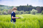 Boy playing in a scenic field — Stock Photo