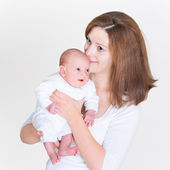 Young mother holding her newborn baby — Stockfoto