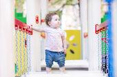 Little girl climbing on a playground — Stock Photo