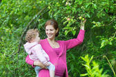 Woman and her baby daughter — Stock Photo