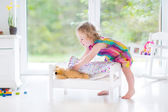 Toddler girl with her toy bear — Stock Photo