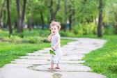 Girl walking in a beautiful summer garden — Stock Photo