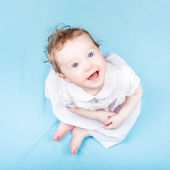 Girl in a white dress on a blue blanket — Foto Stock