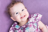 Little girl in a purple dress — Stock Photo
