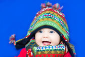 Funny baby in a colorful knitted hat — Stock Photo
