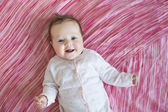 Baby on pink sheet — Stock Photo