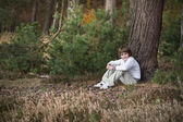 Little boy in a pinewood forest — Stock Photo