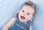 Laughing happy baby girl — Stock Photo