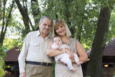 Grandfather with daughter and granddaughter — Stok fotoğraf