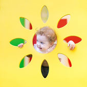 Curly baby girl playing — Stock Photo