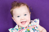 Baby girl on a purple blanket — Stock Photo
