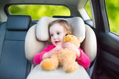 Cute toddler girl in a car seat during vacation trip — Stock Photo