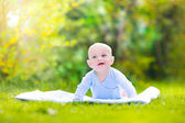 Cute laughing baby in the garden — Stock Photo