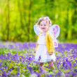 Toddler girl in fairy costume in bluebell forest — Stock Photo #46990019
