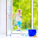 Little girl washing a window — Stock Photo #46990603