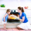 Mother and baby daughter baking a pie — Stock Photo #46991089
