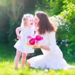 Happy mother and her daughter in the garden — Stock Photo #47035127