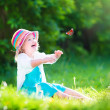 Toddler girl playing with butterfly — Stock Photo #47035327