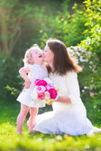 Happy mother and her daughter in the garden — Stock Photo