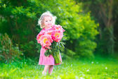 Little girl with peany flowers — Stock Photo